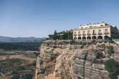 scenic view of building on rock against mountains landscape, Ronda, spain