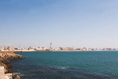 panoramic view of spanish city coastline under blue sky