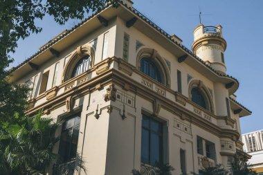 view of building facade under blue sky, Seville, spain