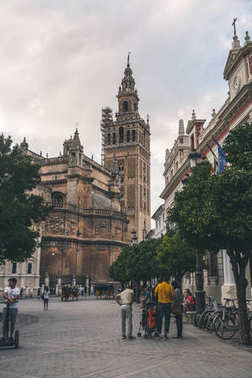 view of city street wih Seville Cathedral, spain