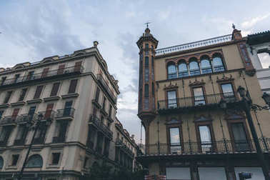 buildings facades under beautiful cloudy sky, spain