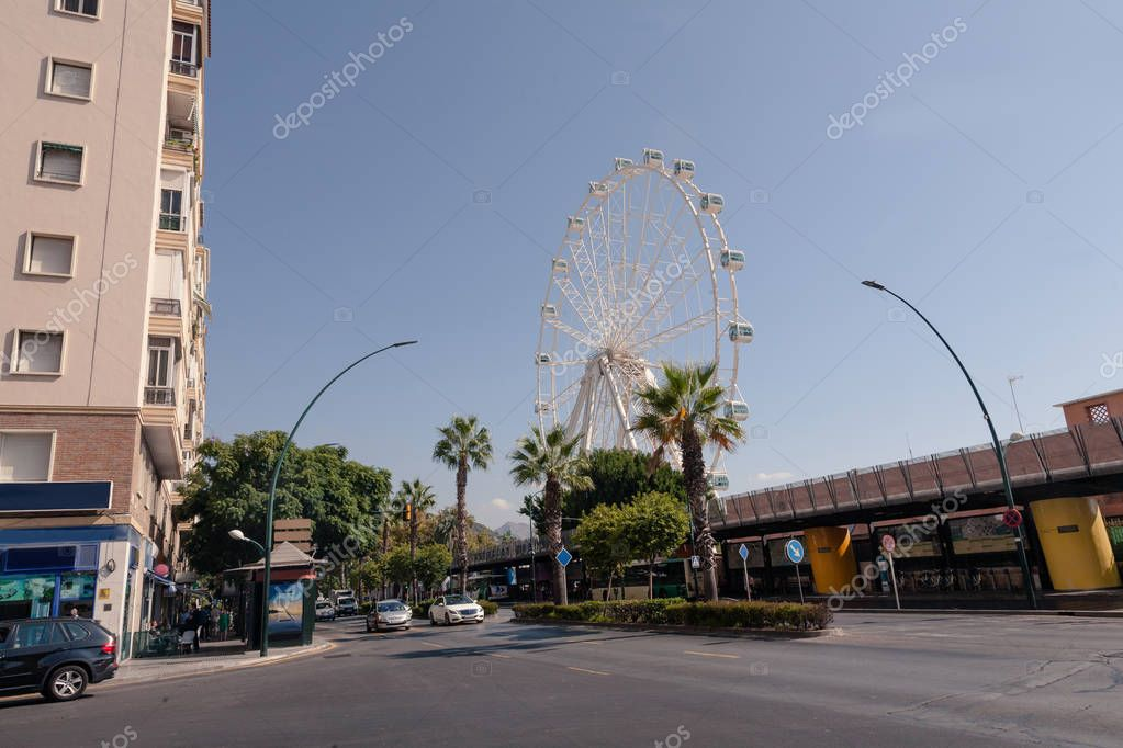view of spanish street with ferris wheel