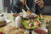 partial view of person eating healthy tasty breakfast