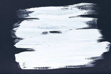 abstract painting with white brush strokes on black