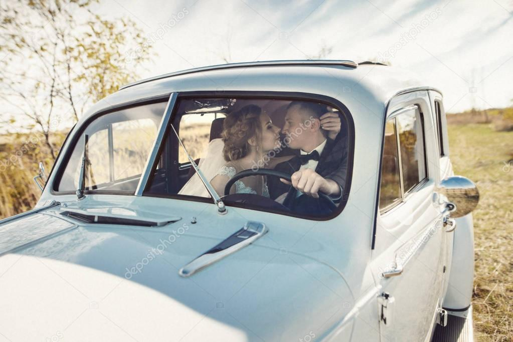 Newlyweds in old vintage car, wedding couple — Stock Photo © VlaDee ...