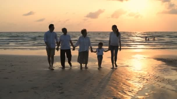 Holiday concept. Big family walking hand in hand on the beach. 4k Resolution.