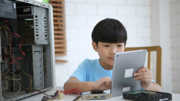 Learning concepts. The boy is learning to repair the computer in the house. 4k Resolution.