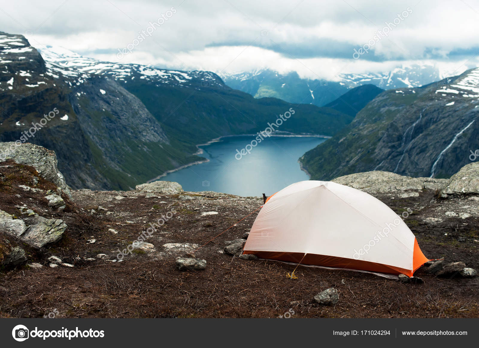 Tent on mountain cliff edge trolltunga u2014 Photo by IuliiaVersta & Tourist tent on the top of the mountain u2014 Stock Photo ...