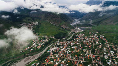 aerial view of city in mountains
