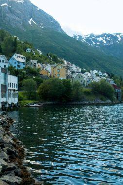 Buildings on riverside in Norway