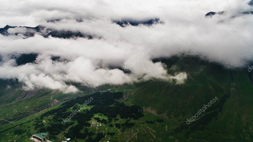 scenic mountains with clouds