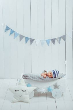 Innocent little infant baby lying in wooden baby cot stock vector