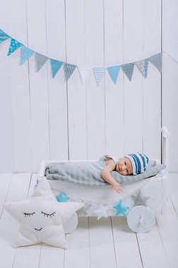 innocent little infant baby lying in wooden baby cot
