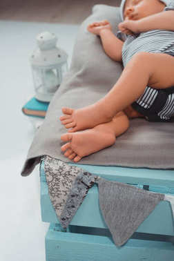 selective focus of sleeping baby on blue wooden box
