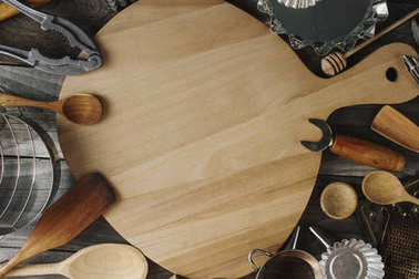 various kitchen utensils on rustic wooden table