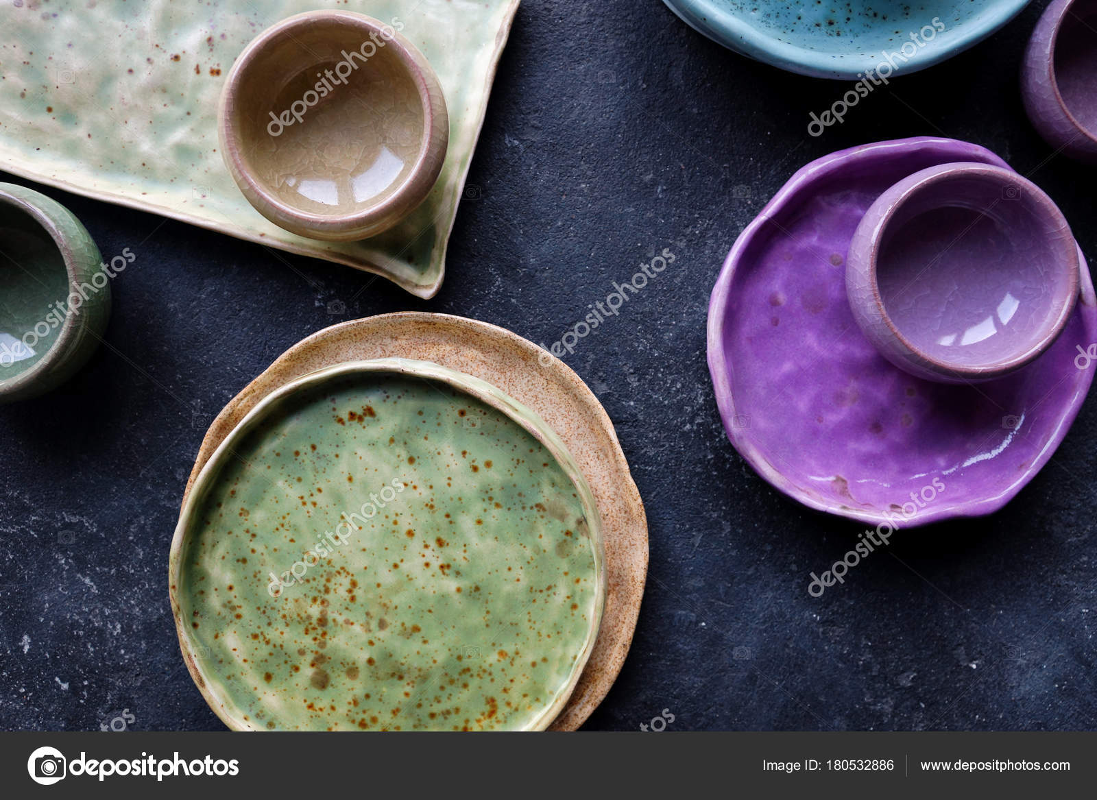 Homemade rustic crockery colorful ceramic plates and bowls on dark stone concrete background. Cozy kitchen concept. Top view selective focus u2014 Photo by ... & Homemade rustic crockery colorful plates and bowls on dark stone ...