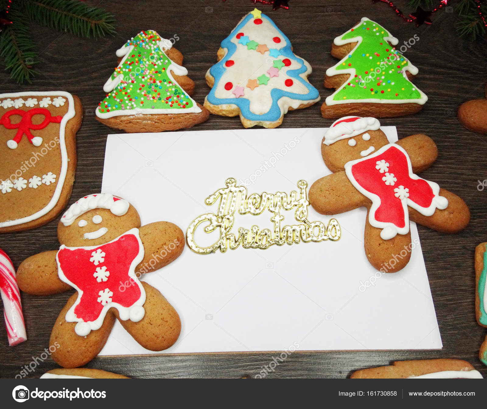 christmas cookies greeting card and decoration on wooden backgro ...