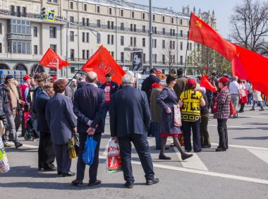 Moscow, Russia - May 1, 2018: Celebrating International Workers' Day at Teatralnaya Square. People with a portrait of Stalin, red flags and the flag of the VKP(b) -Russian Communist Party (Bolsheviks)