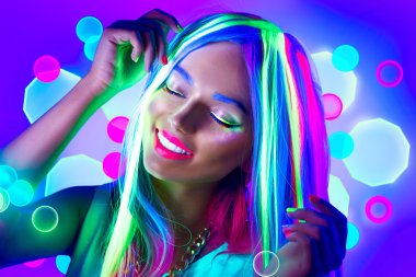 Young woman dancing in neon light