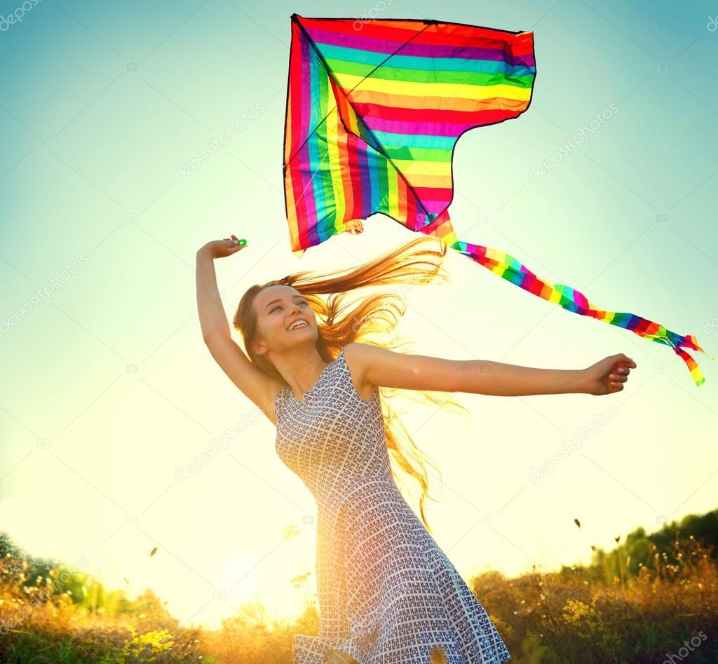 Beauty girl  running with kite