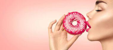 fashion model girl holding sweet pink doughnut