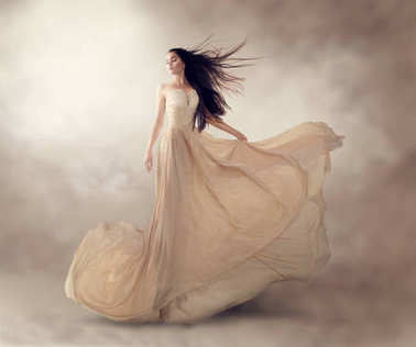 model in luxury beige flowing chiffon dress