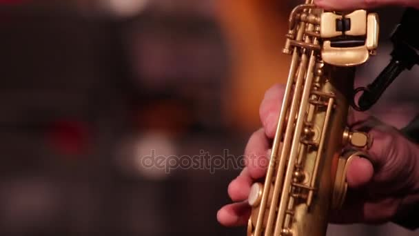 Close-up part of a woodwind instrument soprano saxophone while playing music.