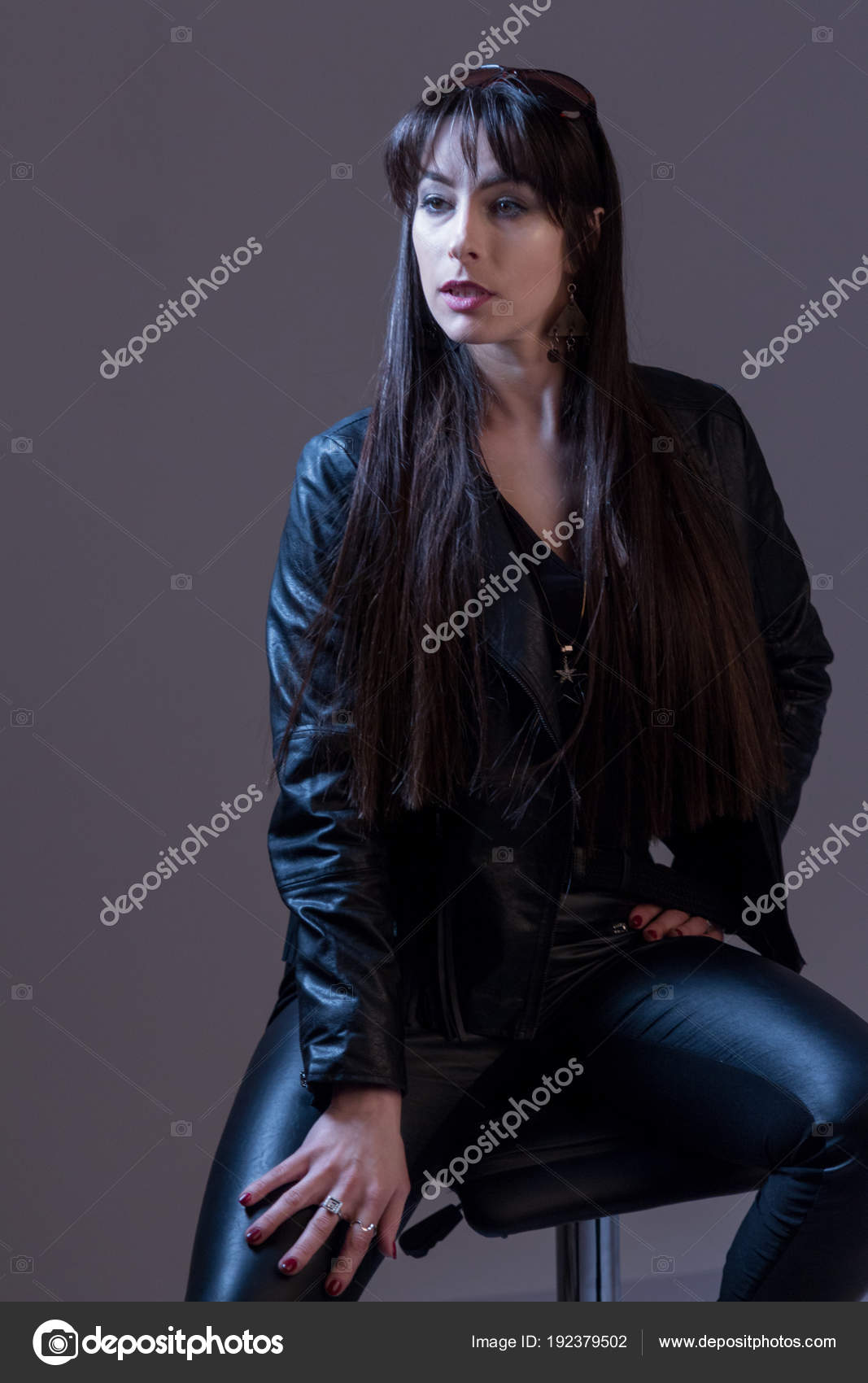 11c9801f7a1 Portrait of a sexy beautiful girl with long hair in black leather ...