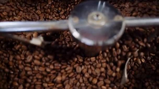 Cooling coffee beans after roasting. Roasting, closeup, slow motion