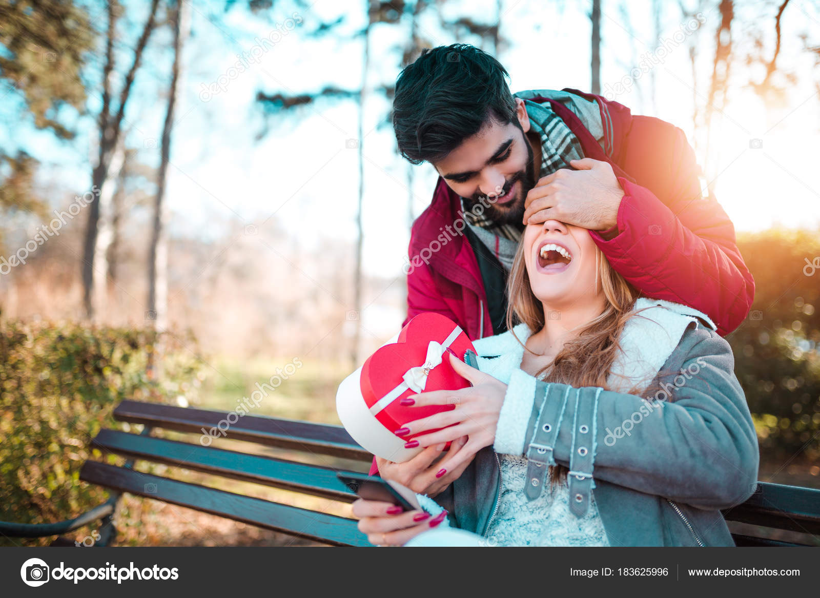 Young Man Giftbox Closing His Girlfriend Eyes Make Surprise Her Stock Photo