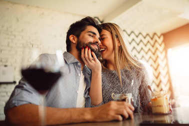 Couple laughing and enjoy their moments in cafe.