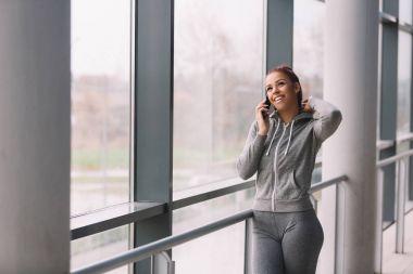 Woman in sport wear talking on mobile phone