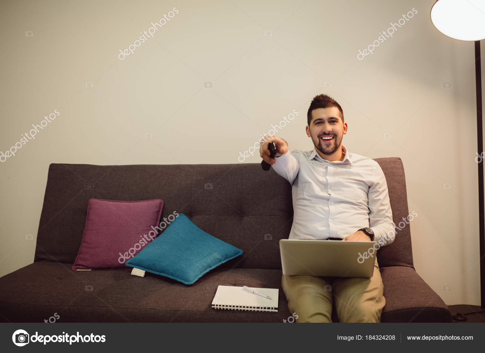 Young Man Using Laptop Watching While Sitting Comfortable ...