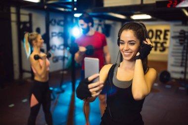 woman taking selfie in gym