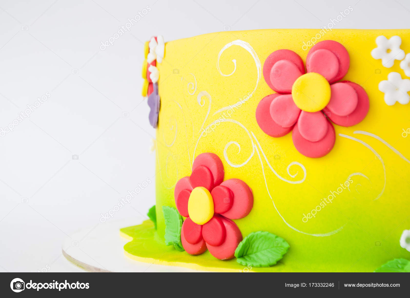 Colorful Childrens Birthday Cake Made Of Yellow Mastic Decorated With Pink Flowers Leaves Pattern On A White Background Close Up Cutout