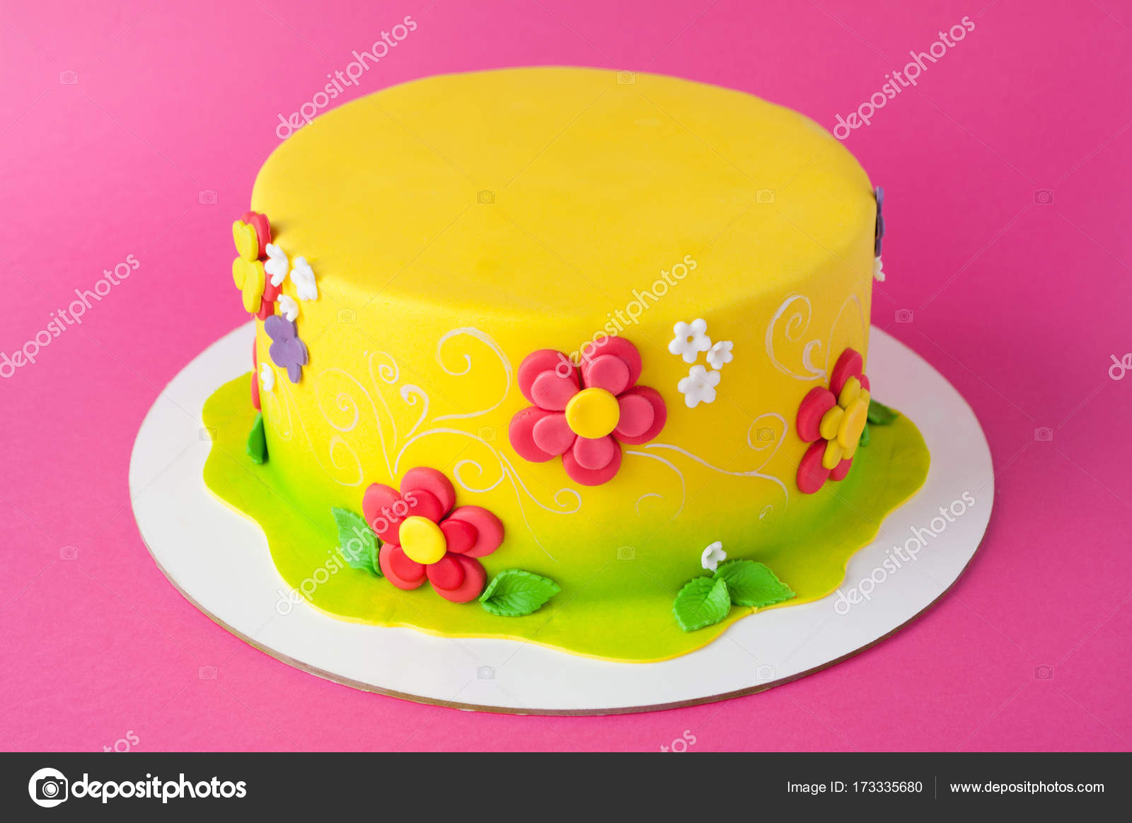 Colorful Childrens Birthday Cake Made Of Yellow Mastic Decorated With Pink Flowers Leaves Pattern On A Background Close Up Cutout