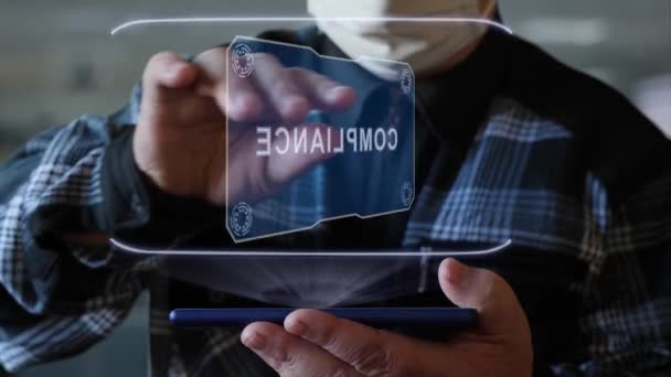 Old man shows hologram with text Compliance