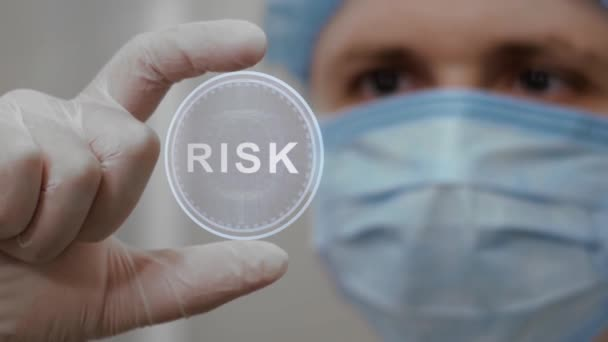 Doctor looks at hologram with Risk