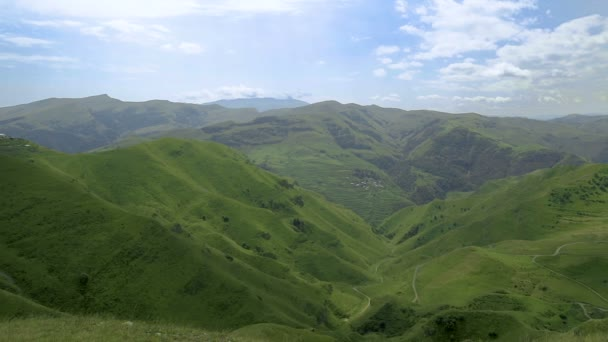 Landscape Caucasus Mountain and Village with Clouds on the Sky