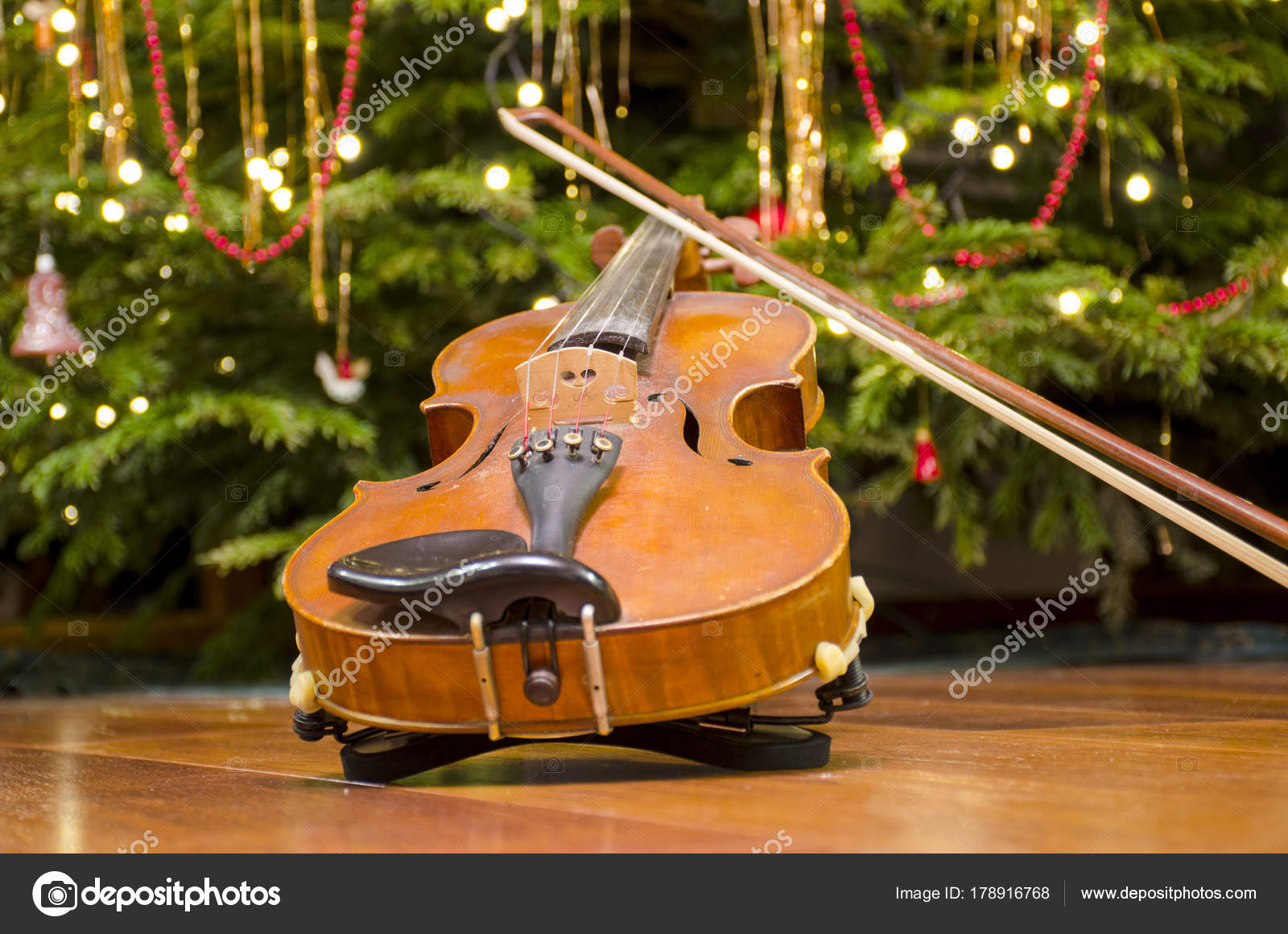 Christmas Violin.The Violin Front Of A Christmas Tree With Decoration Stock