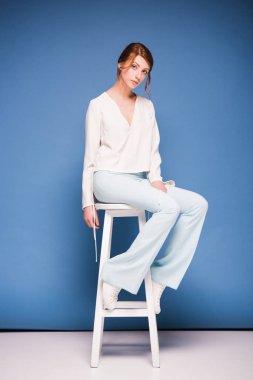 beautiful woman sitting on chair