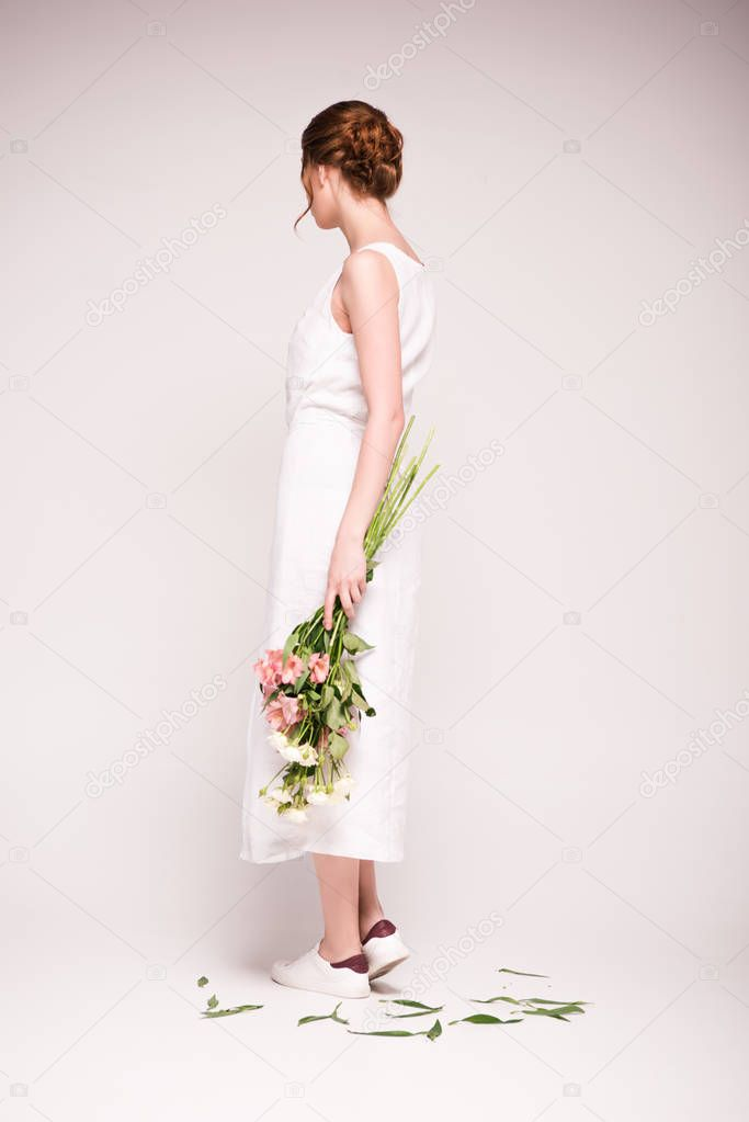 Girl in white dress with flowers