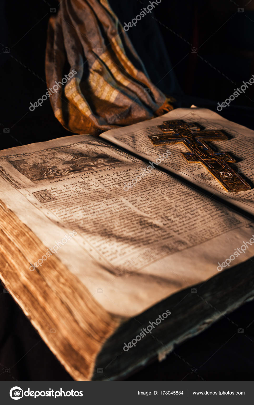 Old Russian orthodox bible on the table with a gold cross