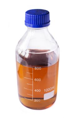 Close up of brown synthetic oil in glass bottle on white background