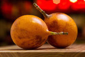 Fotografie Exotic fruits of  maracuja on wooden desk