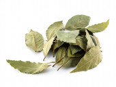Dry Bay leaves for use in cooking and medicine. Bay leaf as a folk medicine with beneficial properties. Bay leaf on white background.