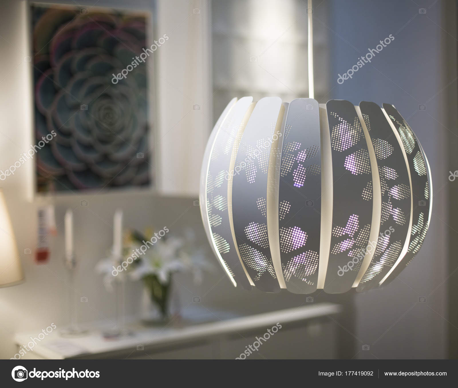 White Lampshade Hanging On A Blurred Background Of Candles And F