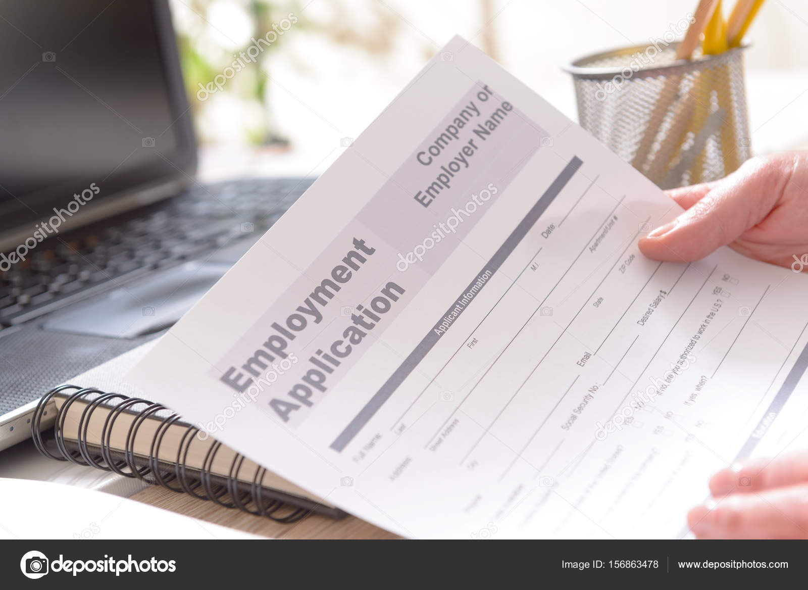 holding blank employment application form stock photo amaviael