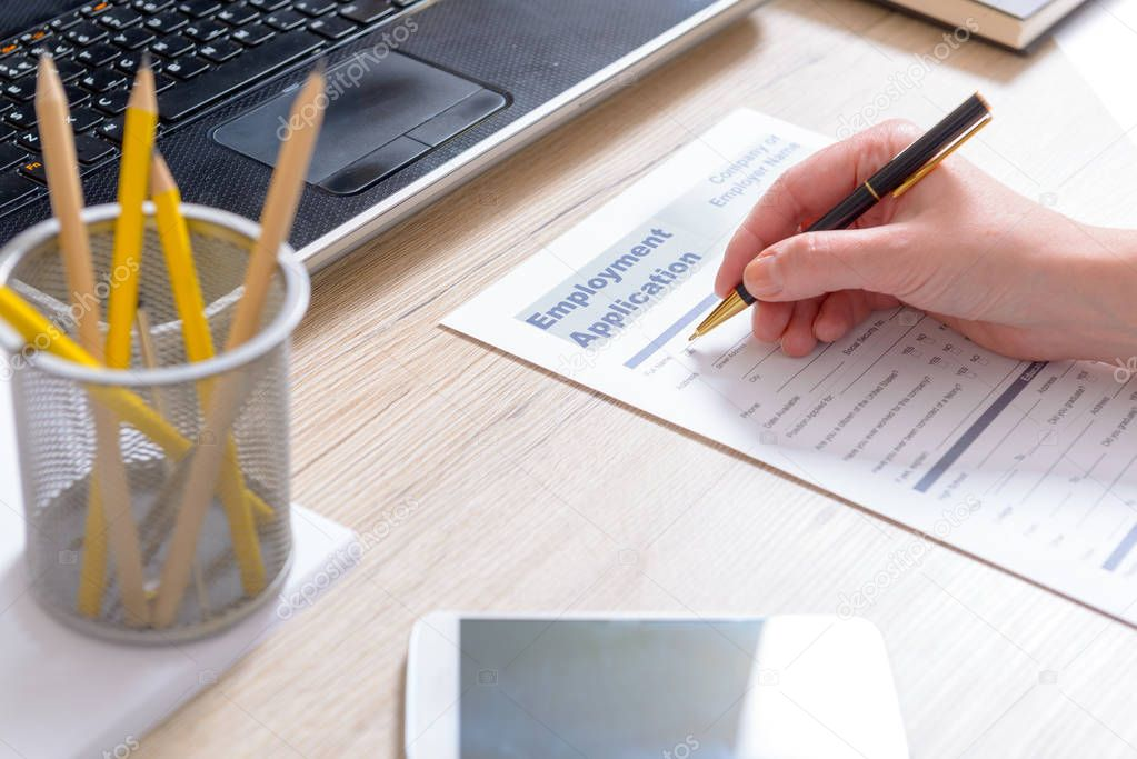 Filling in blank employment application form