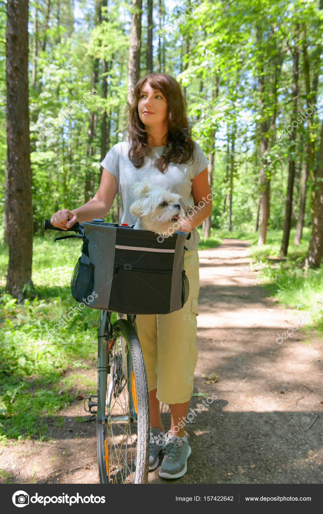 woman riding a bike with her dog — stock photo © amaviael #157422642
